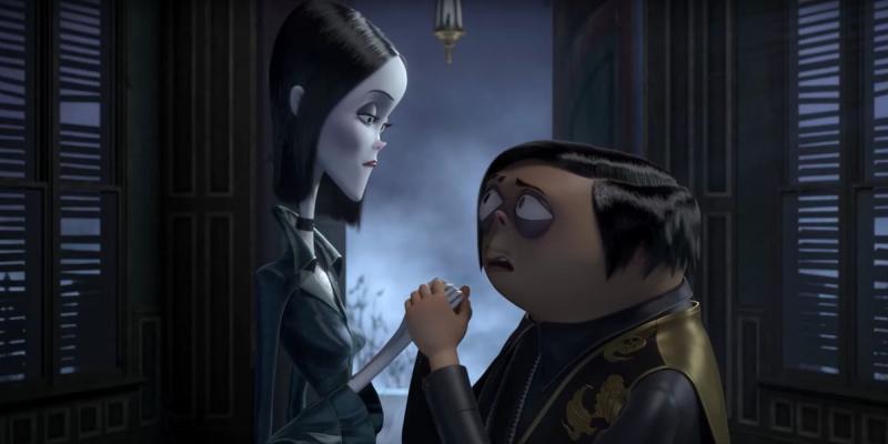 Rodzina Addamsów - bohaterowie podczas obiadu w pierwszym klipie